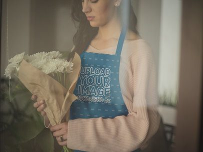Apron Mockup Being Worn by a Girl Holding a Bouquet of Flowers a19825