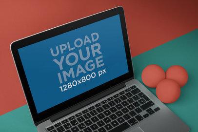 MacBook Mockup Near Three Balls a20328
