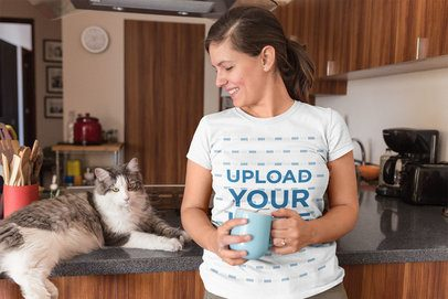Cat Lady Wearing a T-Shirt Mockup Holding a Cup of Coffee a18970