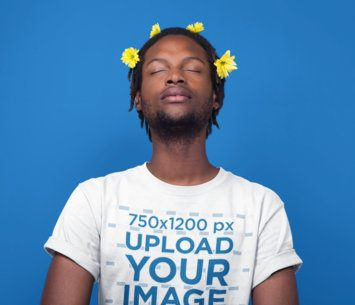 Black Man Meditating Wearing a T-Shirt Mockup and Flowers on his Head a19921