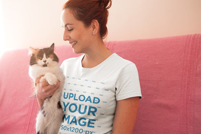 Happy Woman Wearing a T-Shirt Mockup Smiling at her Cat a18980