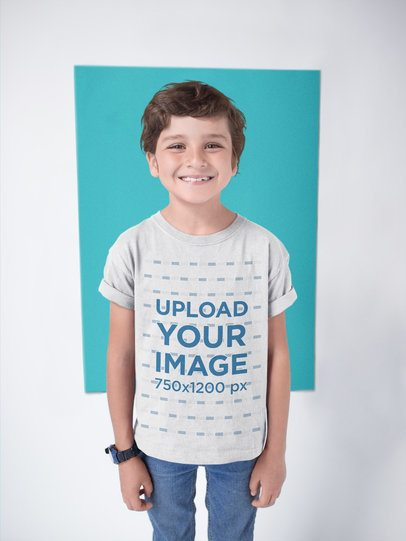 Happy White Kid Wearing a T-Shirt Mockup Against a Color Rectangle a19482