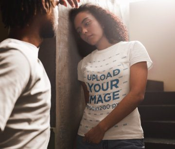Woman Leaning Against a Wall Wearing a T-Shirt Mockup a20094