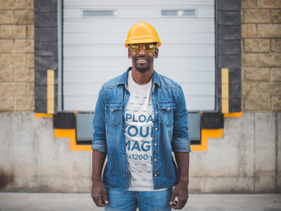 Smiling Man Wearing a T-Shirt Mockup and a Yellow Hard Hat a20453