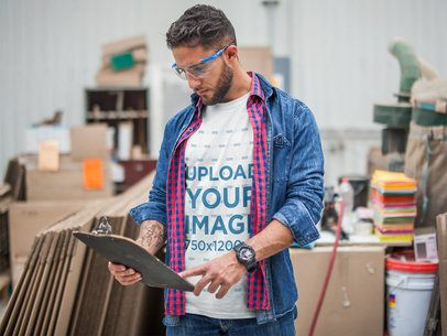 Manager Wearing a Tshirt Mockup and a Denim Jacket while Checking Stock a20442