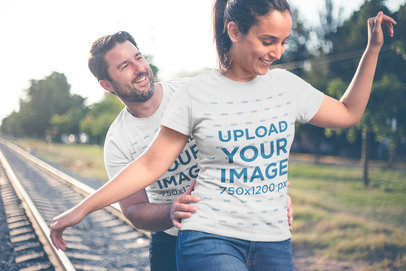 Couple Playing by the Tracks Wearing T-Shirts Mockup a20613