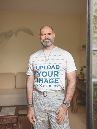 T-Shirt Mockup of a Veteran in his Living Room a20621