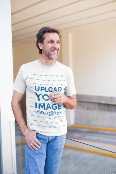 Middle-Age Man Wearing a T-Shirt Mockup While Smoking Outside the Parking Lot a20318