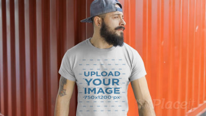 Dude with a Snapback Hat Wearing a T-Shirt Video Mockup at a Dockyard a12264