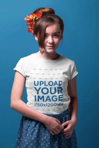 Portrait of a Little Girl Wearing a T-Shirt Mockup Against a Solid Background a19587
