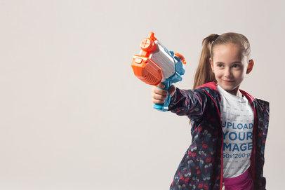 Blonde Girl Wearing a T-Shirt Mockup Shooting a Water Gun a19734
