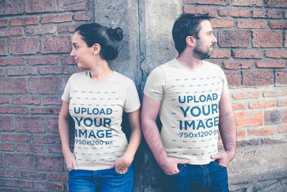 t-shirt mockup featuring a couple leaning over a brick wall a20618