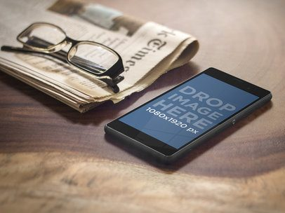 Sony Xperia With Glasses and Newspaper