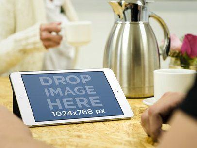 Couple Having Coffee and Using iPad