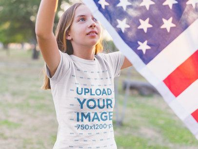 Girl Hanging the American Flag Wearing a T-Shirt Mockup a20706