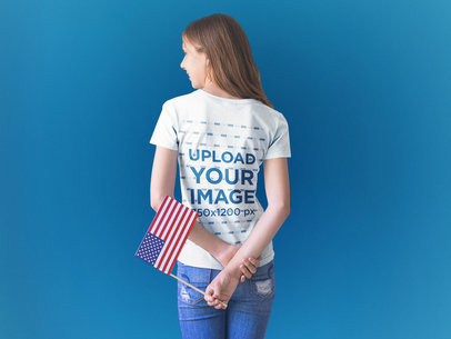 Back of a Girl Wearing a T-Shirt Mockup While Holding a Small American Flag a20705