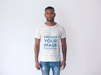 Front Shot of a Tshirt Mockup Featuring a Man in a White Room 20739