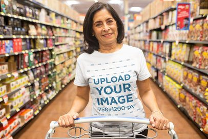 Senior Lady Wearing a T-Shirt Mockup while Grocery Shopping at the Supermarket a20356