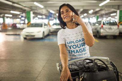Woman Making a Phone Call Wearing a T-Shirt Mockup at a Parking Lot a20351