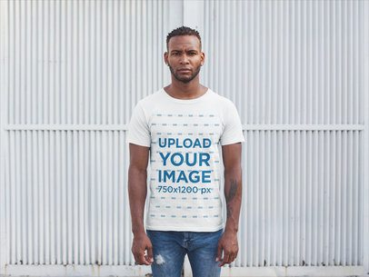 Front Shot T-Shirt Mockup Featuring a Man Against a White Metal Door 20746