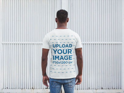 Back Shot Tshirt Mockup of a Man Facing a White Metal Door 20746