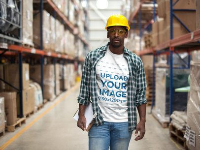 Black Man Wearing a T-Shirt Mockup and a Plaid Shirt at the Warehouse a20382
