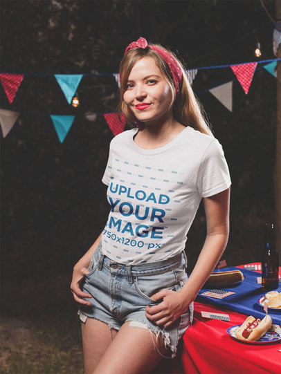 Smiling Girl Wearing a Tshirt Mockup at a 4th of July BBQ Party va20827