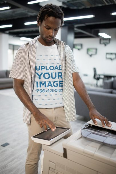 Portrait of a Man with Short locks Wearing a Tshirt Mockup Using a Printer a20514