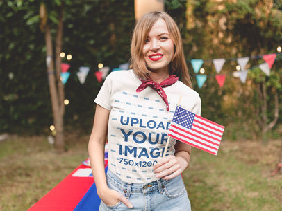 Smiling Patriot Girl Wearing a T-Shirt Mockup at a 4th of July BBQ Party a20819