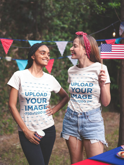 Interracial Pair of Friends Wearing Tshirts Mockup at a 4th of July BBQ Party a20836