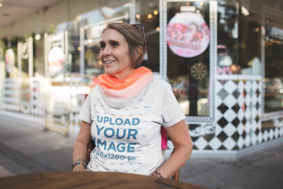 Smiling Elder Woman Wearing a Tshirt Mockup at a Coffee Shop a20672