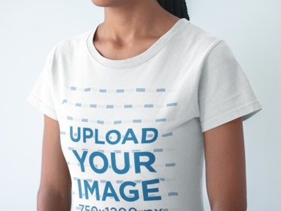 Closeup of a Black Girl Wearing a Tshirt Mockup in a White Room  a20896