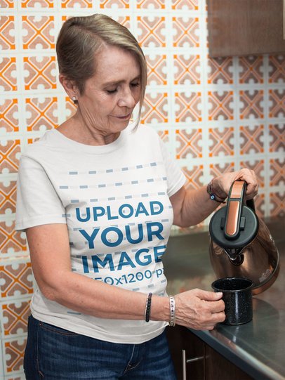 Woman Wearing a Tshirt Mockup Serving a Cup of Coffee a20666