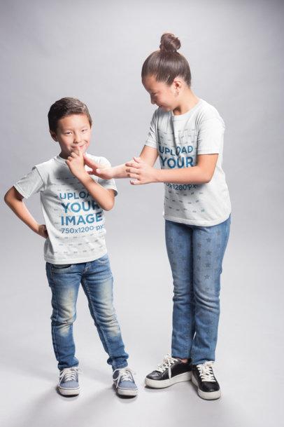 Asian Boy and Girl Wearing T-Shirts Mockup at a Photo Studio a20938