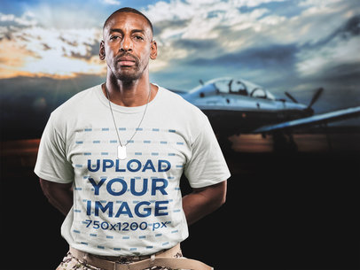 Black Veteran Wearing a T-Shirt Mockup Against a Picture of a Plane a20918