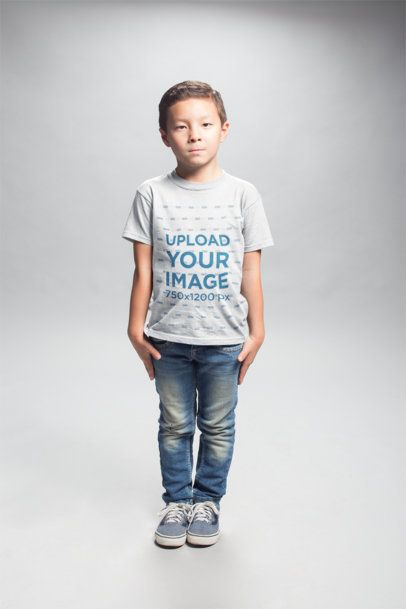 Serious Asian Boy Wearing a T-Shirt Mockup in a White Room a20944