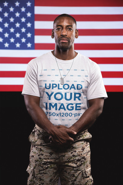 Veteran Wearing a T-Shirt Mockup Standing Against the American Flag a20922