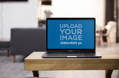 Front Shot of a MacBook Mockup Standing on the Corner of a Wooden Desk a20991