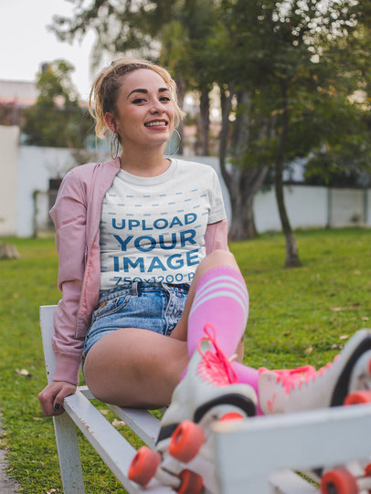 Smiling Girl with Roller Skates Wearing a Round Neck Tee Mockup at the Park a18545
