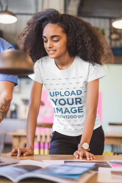 Black Girl Wearing a T-Shirt Mockup while at a Reunion in a Startup a20411