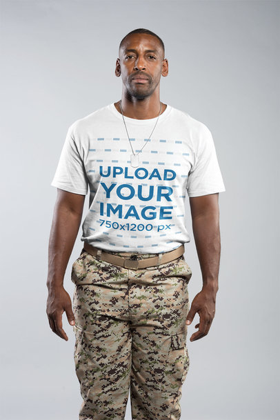 Portrait of a Veteran Soldier Wearing a Round Neck T-Shirt Mockup in a White Room a20930