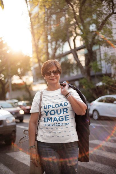 Middle Aged Woman Wearing a T-Shirt Mockup Carrying a Jacket on her Back a20719