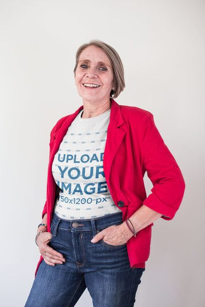 Smiling Elder Woman Wearing a T-Shirt Mockup and a Red Blazer a20668