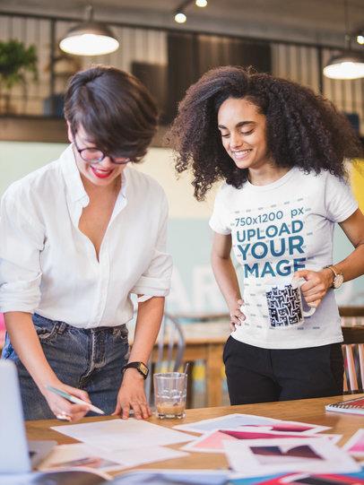 Black Girl Wearing a Tshirt Mockup Looking at a Mood Board a20435