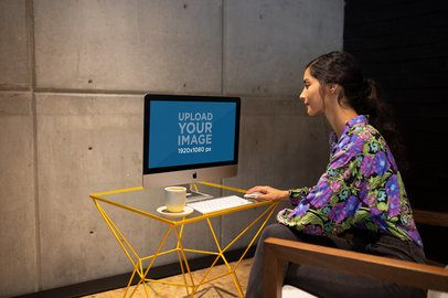 Woman Working on an iMac Mockup Sitting on an Armchair a21178