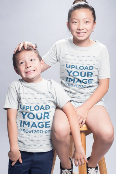 T-Shirt Mockup of a Girl Playing with her Younger Brother a20949