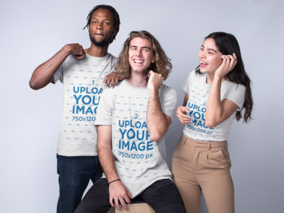 TEST Interracial Group Featuring a Black Dude with a White Guy and an Asian Girl Wearing T-Shirts Mockup a19952