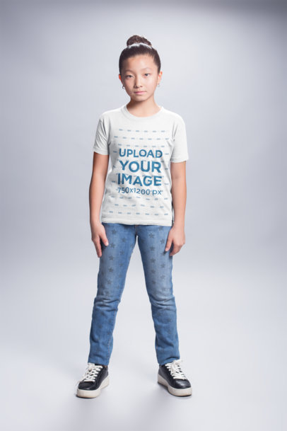 T-Shirt Mockup of an Asian Child Wearing Jeans with Stars a20940