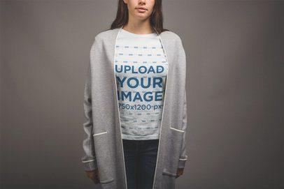 Mockup of a Woman Wearing a Tshirt and a Modern Grey Coat a20865