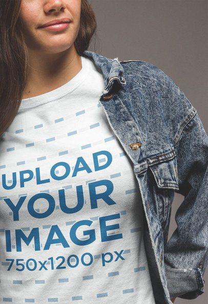 Close-Up T-Shirt Mockup of a Woman Wearing a Denim Jacket a20863